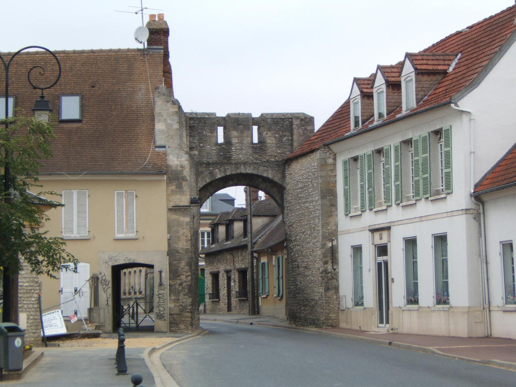 Fortified gate, French Heritage monument to Trie chateau.
